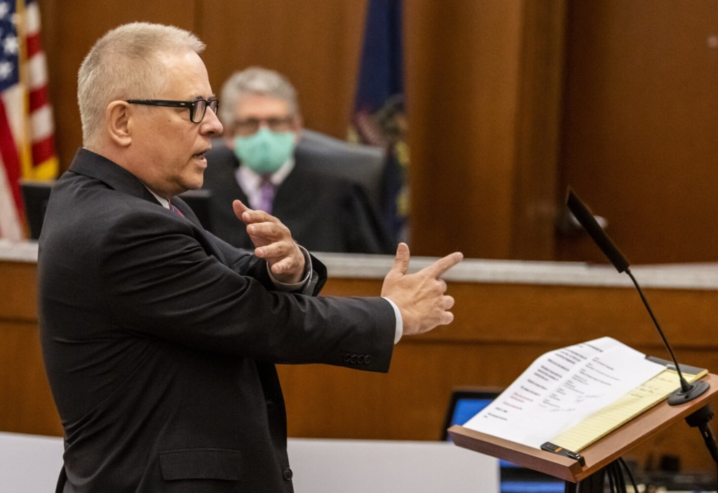 Defense attorney James Howaniec makes a finger gun gesture while describing a  confrontation that ending in a shooting while making opening statement in murder trial of his client Gage Dalphonse Wednesday in the Capital Judicial Center in Augusta.