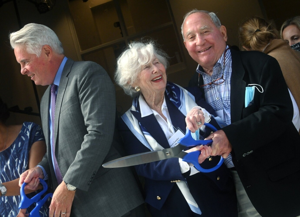 Financial donors Peter H. Lunder, right, and wife Paula Crane Lunder share a fun moment Tuesday during the ribbon-cutting for the Greene Block + Studios. The Lunders donated $3 million dollars toward the project. At left is Colby College President David Greene.