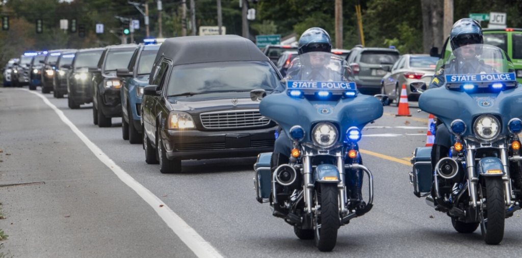 AUGUSTA, ME - SEPTEMBER 23: The hearse carrying the body of Hancock County Deputy Luke Gross is about to turn  Thursday September 23, 2021 off Hospital Street and into the Office of the Chief Medical Examiner in Augusta. (Staff photo by Joe Phelan/Staff Photographer)