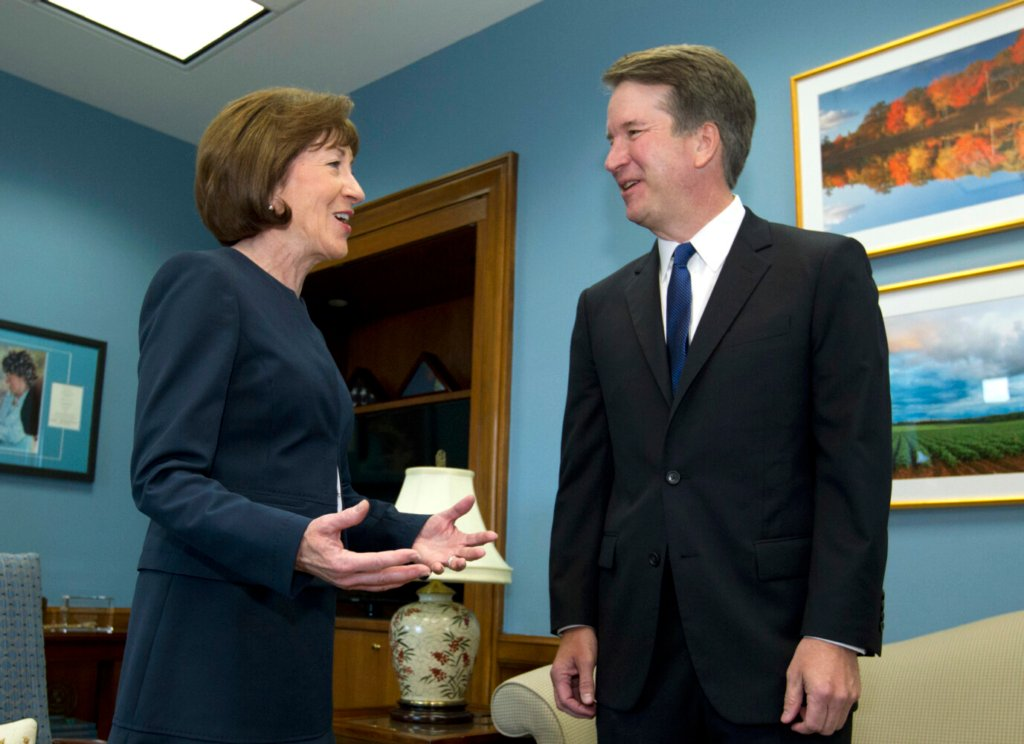 U.S. Sen. Susan Collins, R-Maine, speaks with then Supreme Court nominee Judge Brett Kavanaugh at her office in August 2018. Hers was a crucial vote for his appointment.