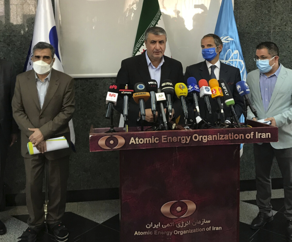 Head of Atomic Energy Organization of Iran, Mohammad Eslami, center, speaks during a joint press briefing with Director General of International Atomic Energy Agency, IAEA, Rafael Mariano Grossi, second right, in Tehran, Iran, Sunday.