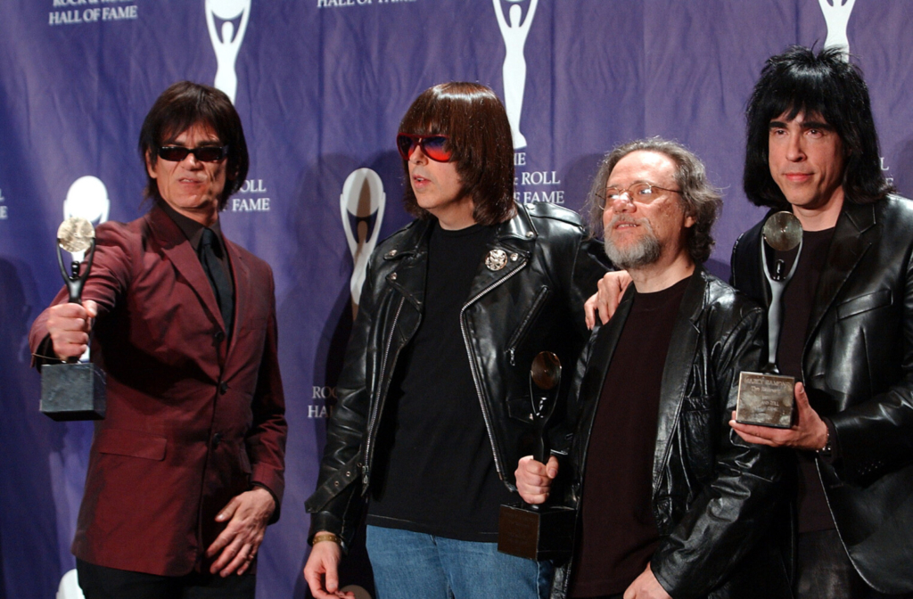 FILE - In this March 18, 2002, file photo, members of the Ramones, from left to right, Dee Dee, Johnny, Tommy and Marky Ramone hold their awards after being inducted at the Rock and Roll Hall of Fame induction ceremony at New York's Waldorf Astoria. A business associate says Tommy, the last surviving member of the original group, has died. Dave Frey, who works for Ramones Productions and Silent Partner Management, confirmed that he died on Friday, July 11, 2014. Ramone was 65. (AP Photo/Ed Betz, File)