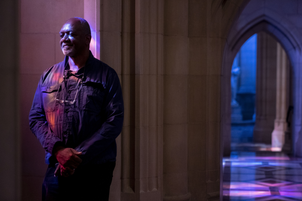 Artist Kerry James Marshall poses for a portrait in the National Cathedral in Washington after being selected to design a replacement of former confederate-themed stained glass windows that were taken down in 2017.
