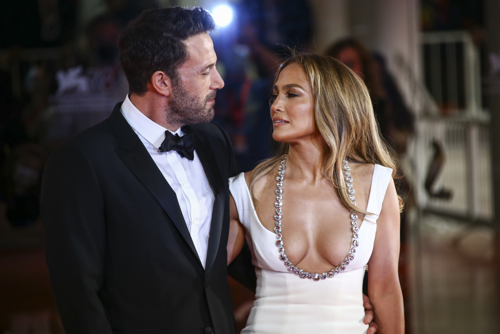 Jennifer Lopez, right, and Ben Affleck pose for photographers upon arrival at the premiere of the film 'The Last Duel' Friday during the 78th edition of the Venice Film Festival in Venice.