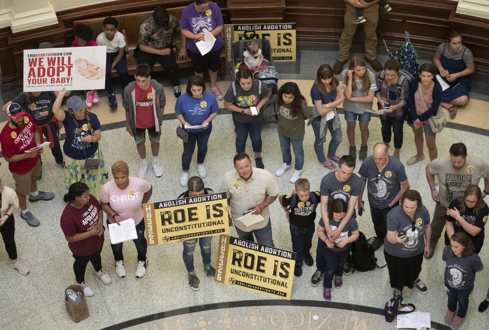 Pro-life demonstrators gather in the rotunda at the Capitol while the Senate debated anti-abortion bills March 30 in Austin, Texas. Even before a strict abortion ban took effect in Texas this week, clinics in neighboring states were fielding more and more calls from women desperate for options.