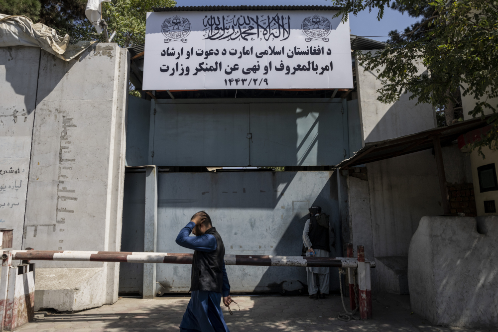 """An Afghan man walks past the former Women's Affairs Ministry building in Kabul, Afghanistan, on Saturday. Afghanistan's new Taliban rulers set up a ministry for the """"propagation of virtue and the prevention of vice"""" in the building. (AP Photo/Bernat Armangue)"""