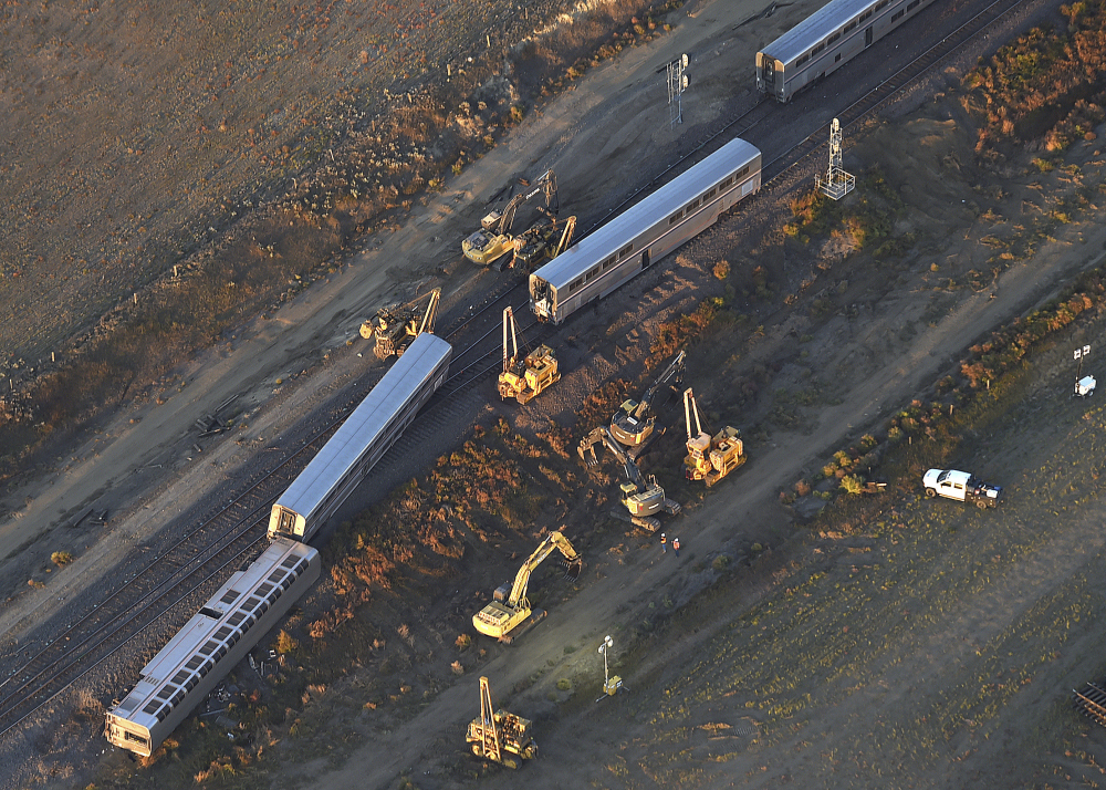 This aerial view taken Sunday shows part of an Amtrak Empire Builder that derailed in north-central Montana Saturday afternoon. The accident didn't involve other trains or other equipment but experts are still determining the official cause.