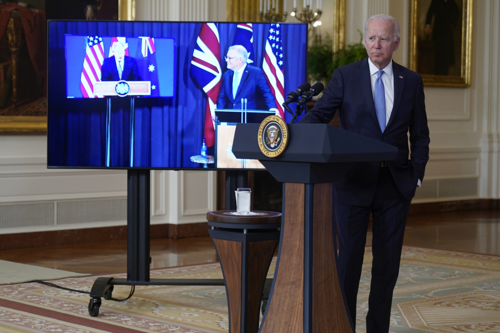 President Joe Biden, joined virtually by Australian Prime Minister Scott Morrison, right on screen, and British Prime Minister Boris Johnson, speaks about a national security initiative from the East Room of the White House in Washington on Wednesday.