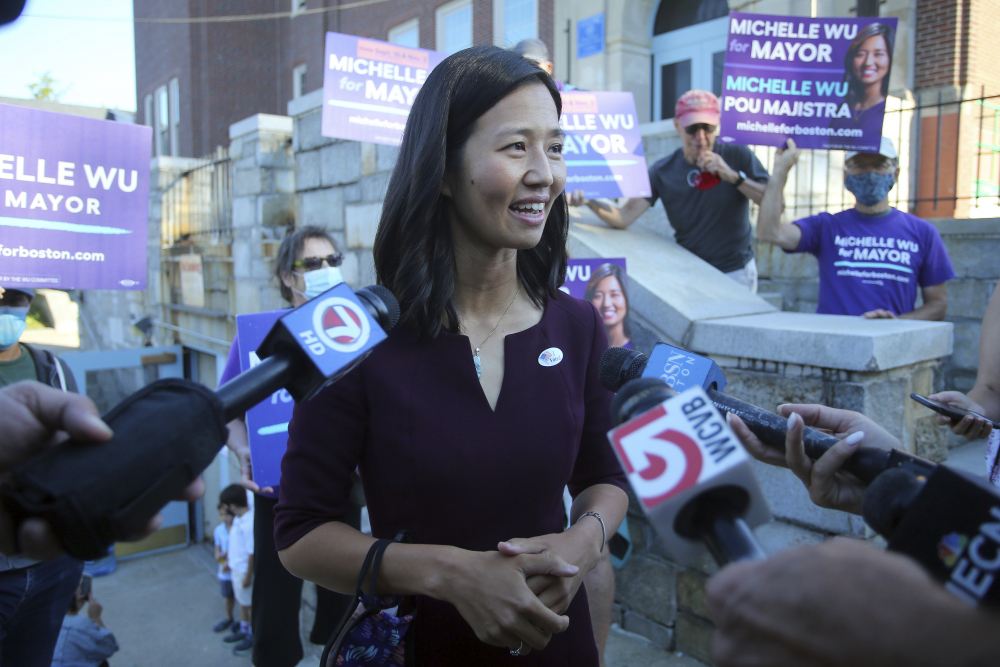 Boston mayoral candidate Michelle Wu speaks with the media after casting her ballot in the mayoral race Tuesday at Phineas Bates Elementary School.