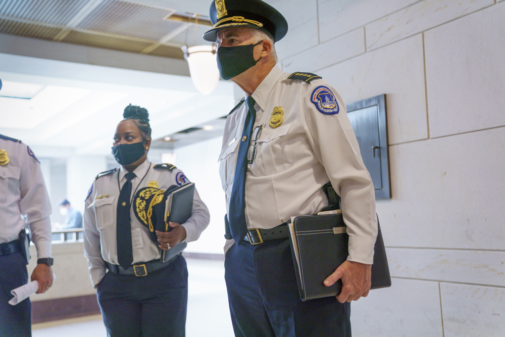 U.S. Capitol Police Chief Thomas Manger, joined at left by Assistant Chief Yogananda Pittman, heads to a closed-door meeting with congressional leaders for a briefing as security officials prepare for a Sept. 18 demonstration by supporters of the people arrested in the Jan. 6 riot, at the Capitol in Washington on Monday.