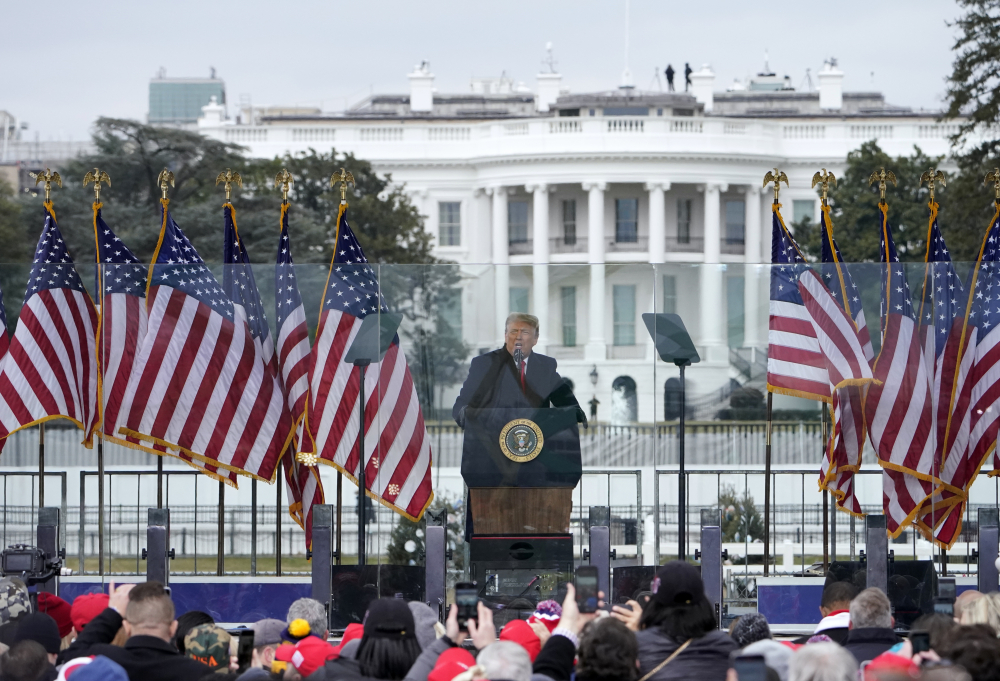 With the White House in the background, then-President Trump speaks at a rally in Washington on the day Joe Biden was certified as winner of the election. At the end of the rally Trump loyalists beat and injured police as they battled their way inside the U.S. Capitol, destroyed property and sent lawmakers running for their lives.