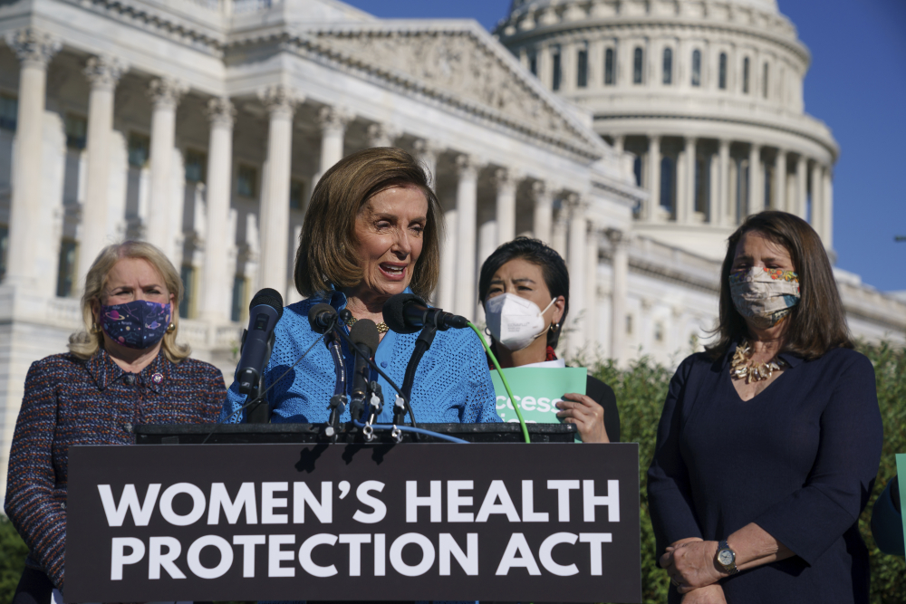 House Speaker Nancy Pelosi, D-Calif., joined from left by Rep. Sylvia Garcia, D-Texas, Rep. Judy Chu, D-Calif., and Rep. Diana DeGette, D-Colo., holds a news conference just before a House vote on legislation aimed at guaranteeing a woman's right to an abortion, an effort by House Democrats to circumvent a new Texas law that has placed that access under threat, at the Capitol in Washington on Friday.