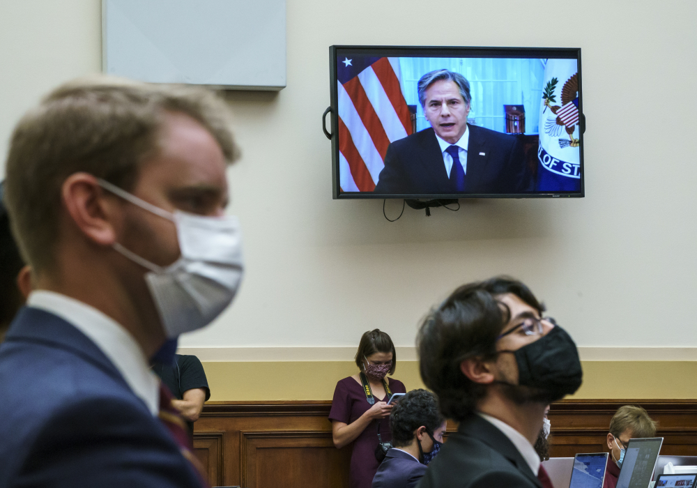 Secretary of State Antony Blinken appears remotely on a TV monitor to answer questions from the House Foreign Affairs Committee about the U.S. withdrawal from Afghanistan, at the Capitol in Washington on Monday.