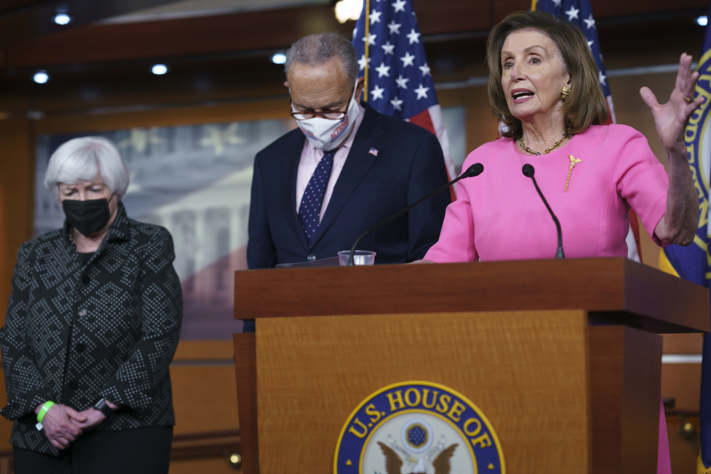"""Speaker of the House Nancy Pelosi, D-Calif., right, Treasury Secretary Janet Yellen, left, and Senate Majority Leader Chuck Schumer, D-N.Y., update reporters on Democratic efforts to pass President Biden's """"Build Back Better"""" agenda, at the Capitol in Washington on Thursday."""
