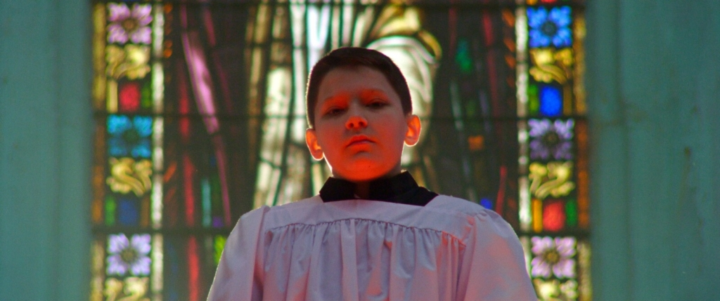 """An altar boy in """"Procession,"""" which is playing at the Camden International Film Festival."""