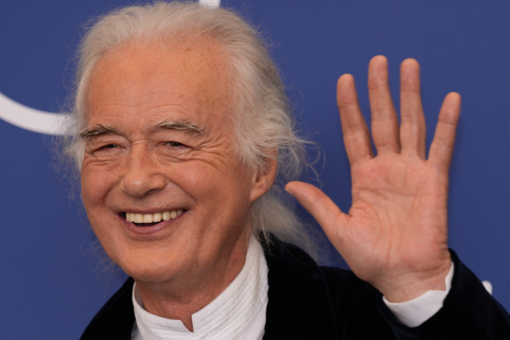 Musician Jimmy Page poses at the photo call of the movie 'Becoming Led Zeppelin' at the 78th edition of the Venice Film Festival at the Venice Lido, Italy, on Saturday. The festival is on through Sept. 11.