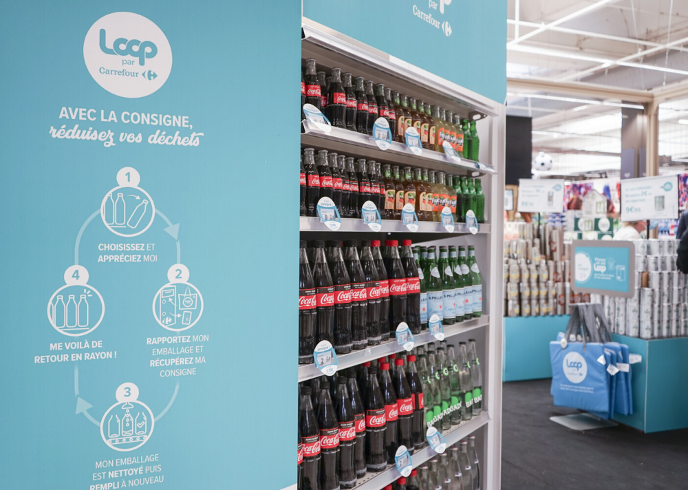 Loop reusable packaging is displayed at French supermarket.  Reusable packaging is about to become more common at groceries and restaurants worldwide.