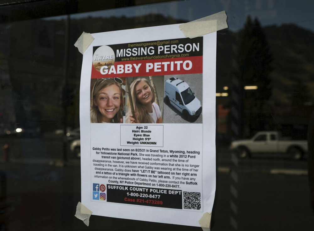 A Suffolk County Police Department missing person poster for Gabby Petito is posted in Jackson, Wyo. Petito, 22, vanished while on a cross-country trip in a converted camper van with her boyfriend. Authorities discovered her body Sunday in Wyoming.