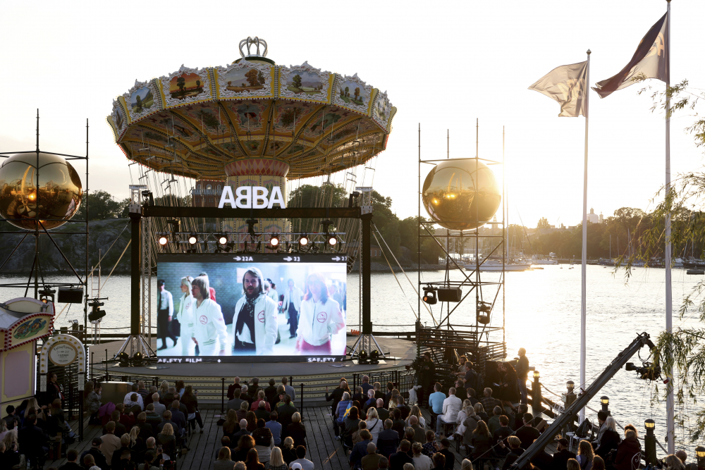 People look at the screen, at the ABBA Voyage event at Grona Lund, in Stockholm, Sweden, Thursday.