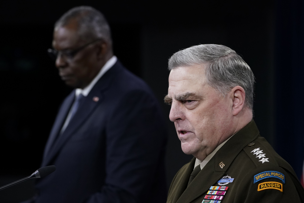 Joint Chiefs of Staff Gen. Mark Milley, right, answers a question during a briefing with Secretary of Defense Lloyd Austin, left, at the Pentagon in Washington on Wednesday about the end of the war in Afghanistan.