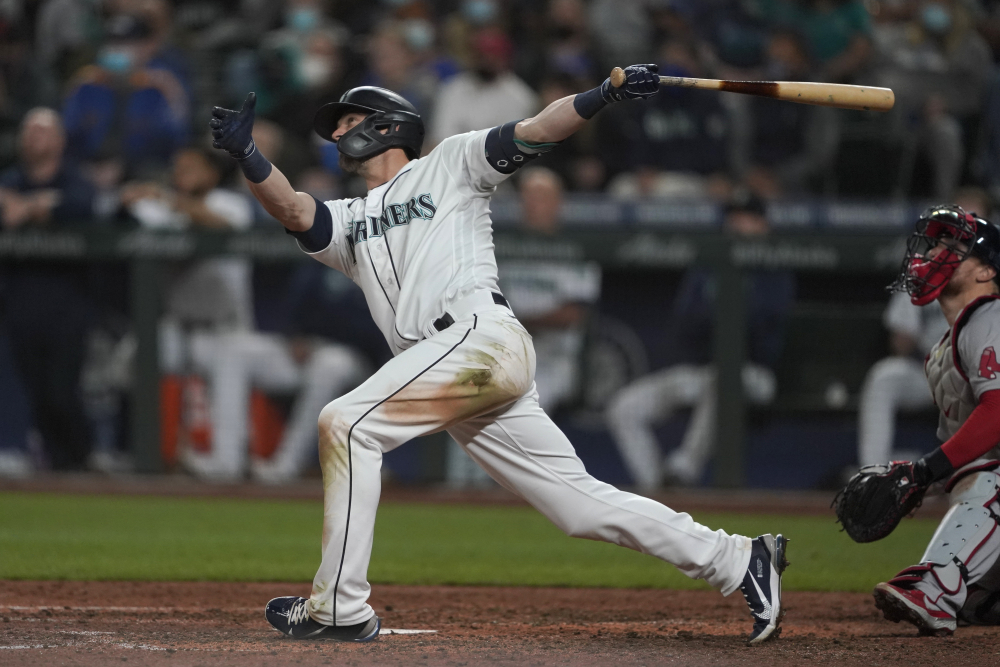 Seattle Mariners' Mitch Haniger follows through on a three-run, go-ahead home run against the Boston Red Sox during the seventh inning Monday night in Seattle.