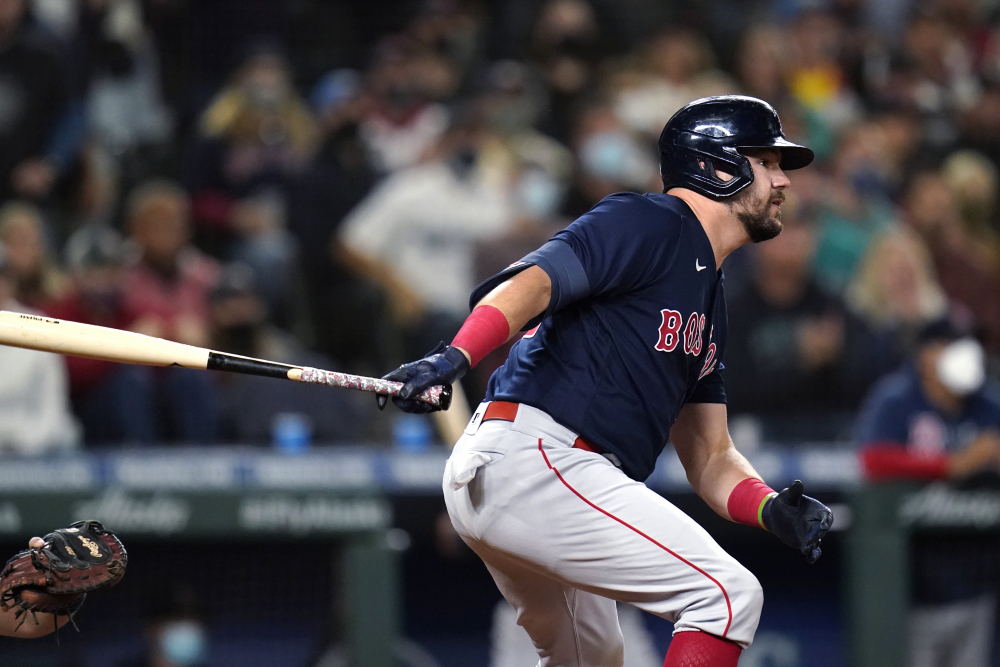 Kyle Schwarber of the Boston Red Sox watches his three-run double against the Seattle Mariners during the eighth inning Tuesday, Sept. 14, 2021, in Seattle.