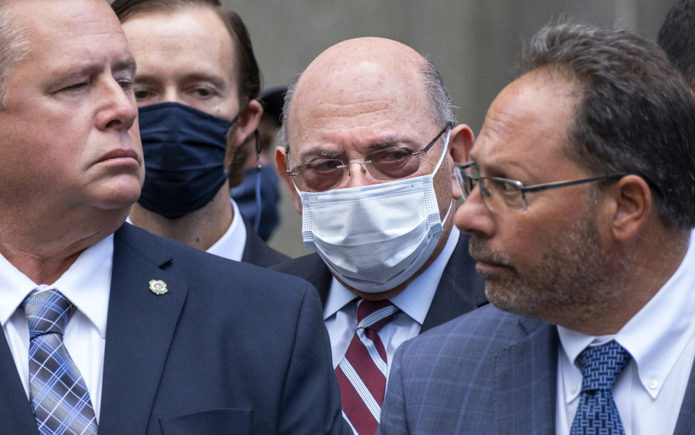 The Trump Organization's Chief Financial Officer Allen Weisselberg, center, awaits a car after leaving a courtroom appearance in New York, Monday, Sept. 20.