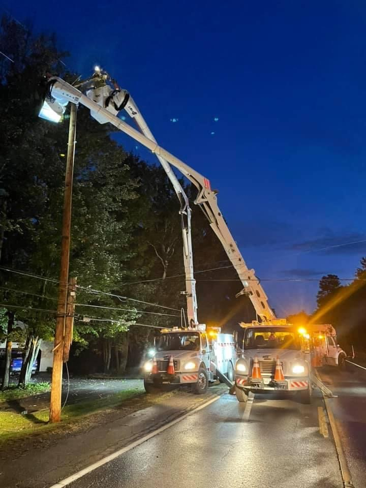 Central Maine Power crews work Saturday morning to replace a utility pole damaged in a single-car crash on Riverside Drive in Vassalboro. Power was restored to the area around 8 a.m.