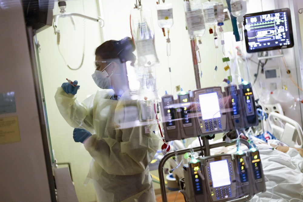 Ann Enderle, R.N., attends to a COVID-19 patient in the medical Intensive care unit at St. Luke's Boise Medical Center in Boise, Idaho, in August.