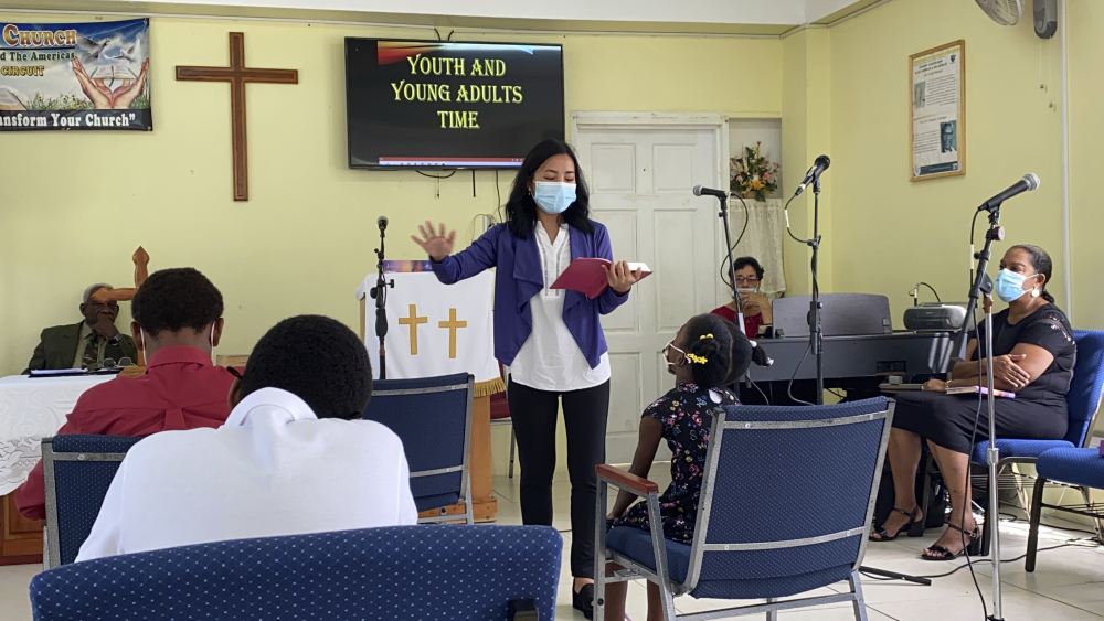 In this 2021 photo provided by Global Ministries, Global Mission Fellow Wingamkamliu Rentta leads youth and young adults in St. Lucia, during her service with the Methodist Church in the Caribbean and the Americas.  The International Mission Board is requiring its missionaries get the COVID-19 vaccine. The board is a Southern Baptist Convention agency and deploys thousands of evangelical missionaries across the globe.