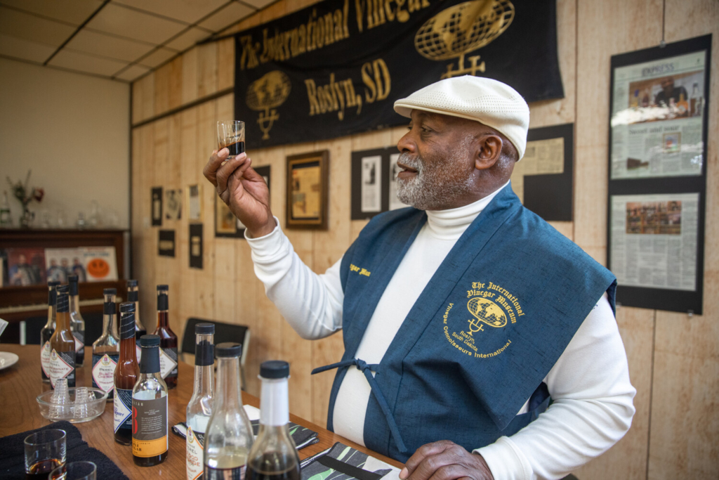 Lawrence Diggs, founder of the International Vinegar Museum in Roslyn, S.D., with some of the 300 bottles in its collections. MUST CREDIT: Photo for The Washington Post by Jay Pickthorn
