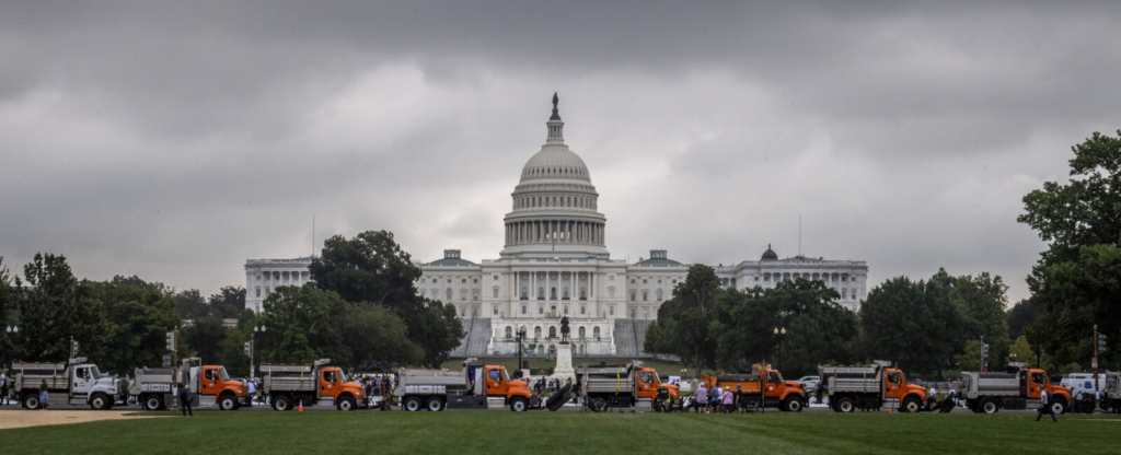 A row of dump trucks parked bumper to bumper as enhanced security around the Capitol for the Justice for J-6 protest rally, in Washington, D.C. MUST CREDIT: Washington Post photo by Bill O'Leary.