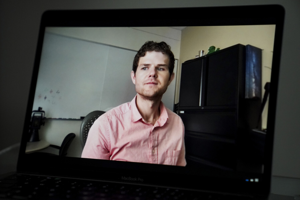 Nick Kneer is shown in his office in Oxford, Ohio on Sept. 22, 2021, as seen via Zoom on a laptop. MUST CREDIT: Washington Post photo by Carolyn Van Houten