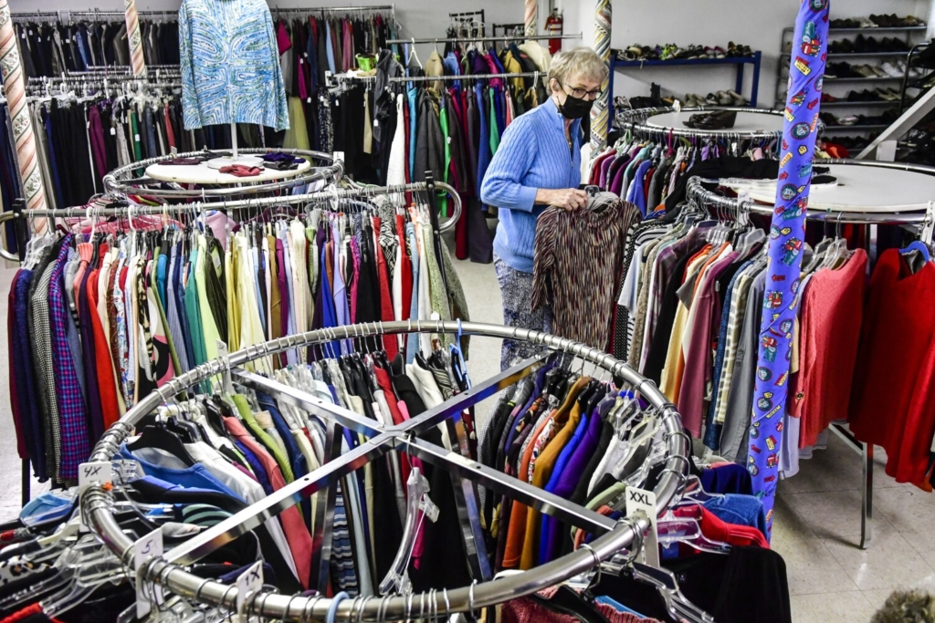 GARDINER, ME - SEPTEMBER 30: Judy Harriman straightens out items in the racks Thursday September 30, 2021 at The Clothes Closet in Gardiner. (Staff photo by Joe Phelan/Staff Photographer)