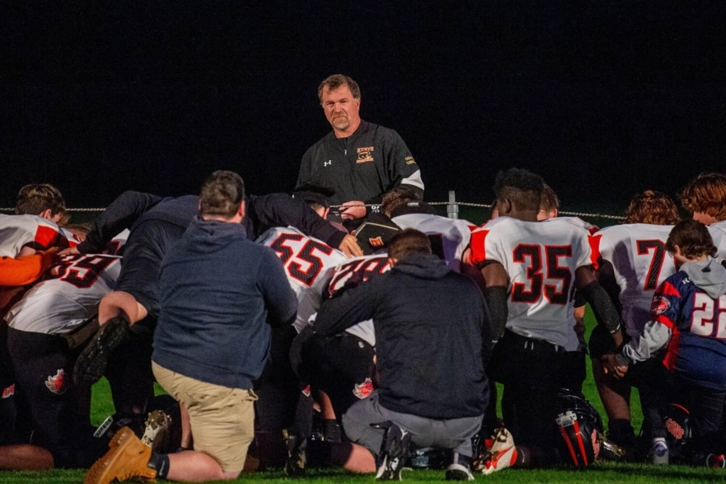 SKOWHEGAN, MAINE- OCTOBER 1, 2021 Brunswick High School kneels in the end zone astray prepare to face Skowhegan High School at Skowhegan High School on Friday,Oct. 1, 2021. (Staff Photo by Michael G. Seamans/Staff Photographer)