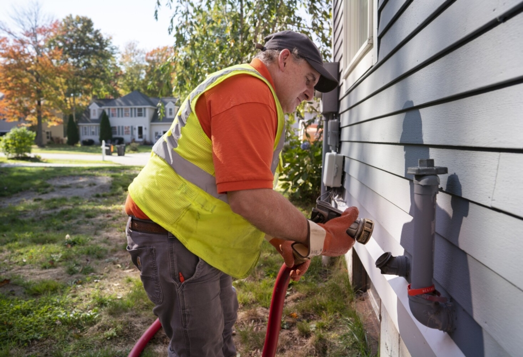 SCARBOROUGH, ME - OCTOBER 13: Paul Sabato, a driver with Heatable, delivers oil to a home in Scarborough on Wednesday, October 13, 2021. After a lull during the pandemic, home energy prices are expected to climb this winter. (Staff photo by Gregory Rec/Staff Photographer)