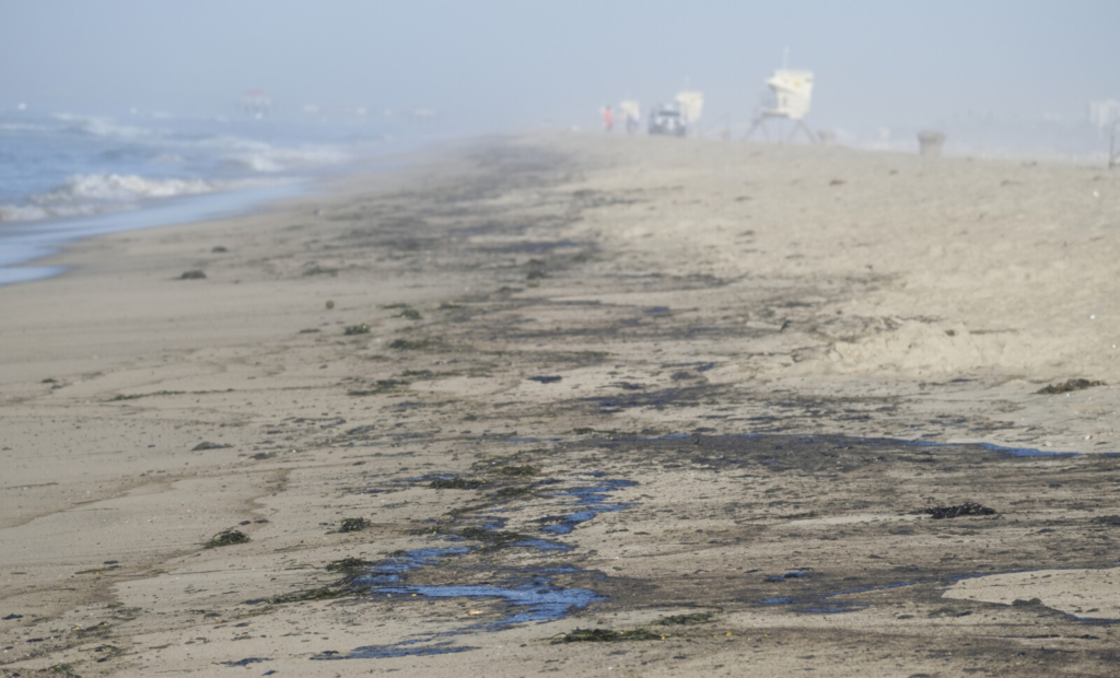 Oil washed up on Huntington Beach, Calif., on Sunday. At least 126,000 gallons of crude spilled into the waters off Orange County.