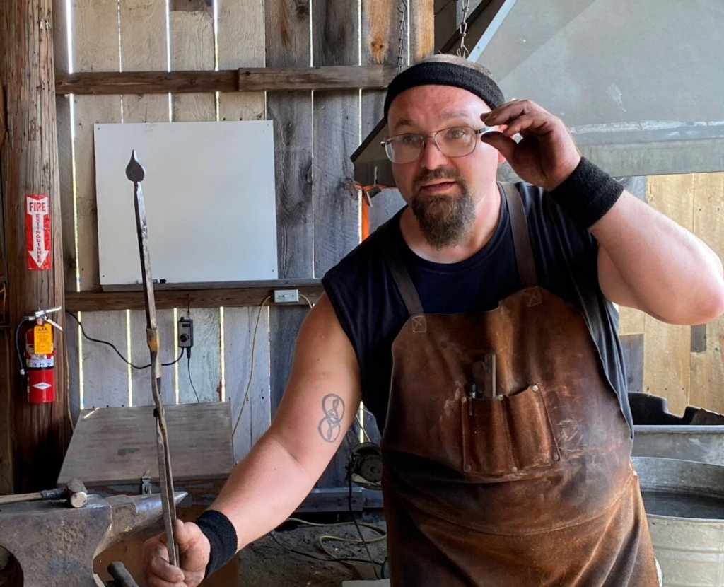 Ryan Adams of Bell Hill Forge in Otisfield demonstrates blacksmithing at the Oxford Fair in Oxford in September. Adams crafted a decorative leaf with an iron rod and 2000-degree fire.