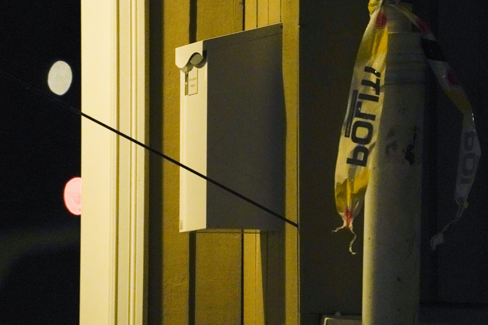 An arrow is seen in the wall after an attack in Kongsberg, Norway, Wednesday.