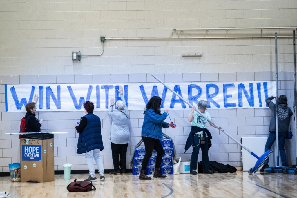 Supporters of Democratic presidential candidate Sen. Elizabeth Warren of Massachusetts gather at the beginning of caucus night at Roosevelt High School in Des Moines on Feb. 3, 2020. MUST CREDIT: Washington Post photo by Melina Mara.