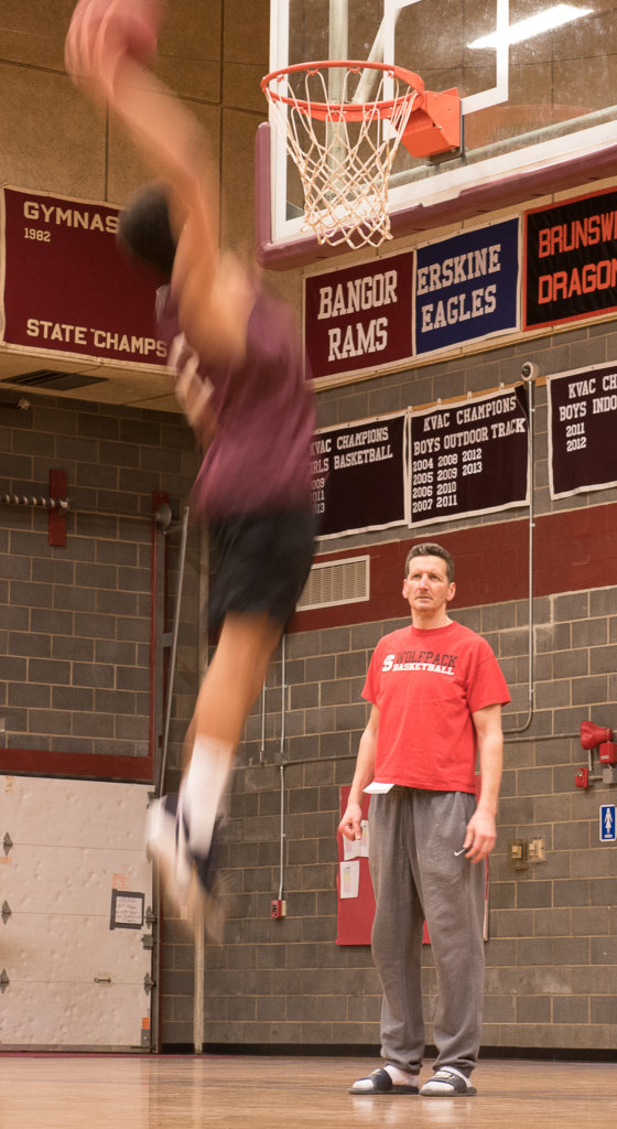 An Edward Little High School basketball player is a blur as the team runs  through a drill during last Wednesday's practice at the school's gym under  the ...