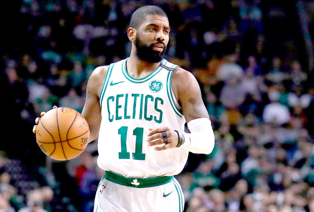 3a47b3910aad Boston Celtics guard Kyrie Irving (11) moves down court during a game in  Boston in February. A person with knowledge of the situation says Irving  will miss ...