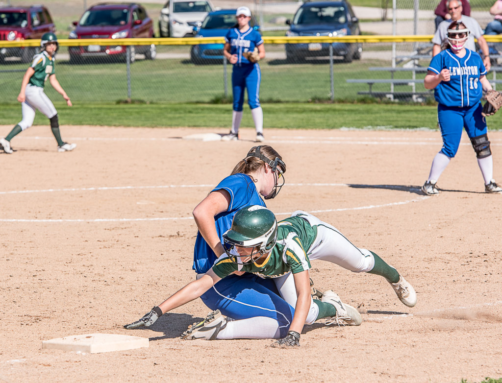 the best attitude da8f5 041d2 Oxford Hills  Brooke Carson attempts to get back to third base past  Lewiston s Jordan Mynahan at a game in South Paris on Wednesday afternoon.