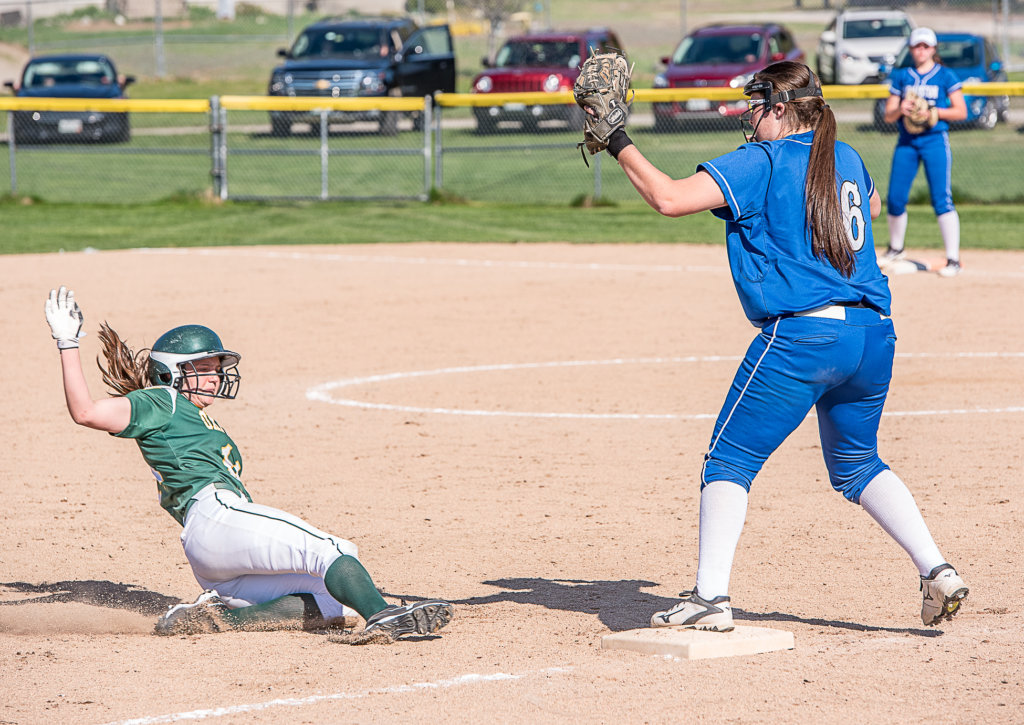 new arrival 9cd44 c1604 Oxford Hills  Ashley Childs slides into third base as Lewiston s Jordan  Mynahan catches the ball during Wednesday afternoon s game in South Paris.