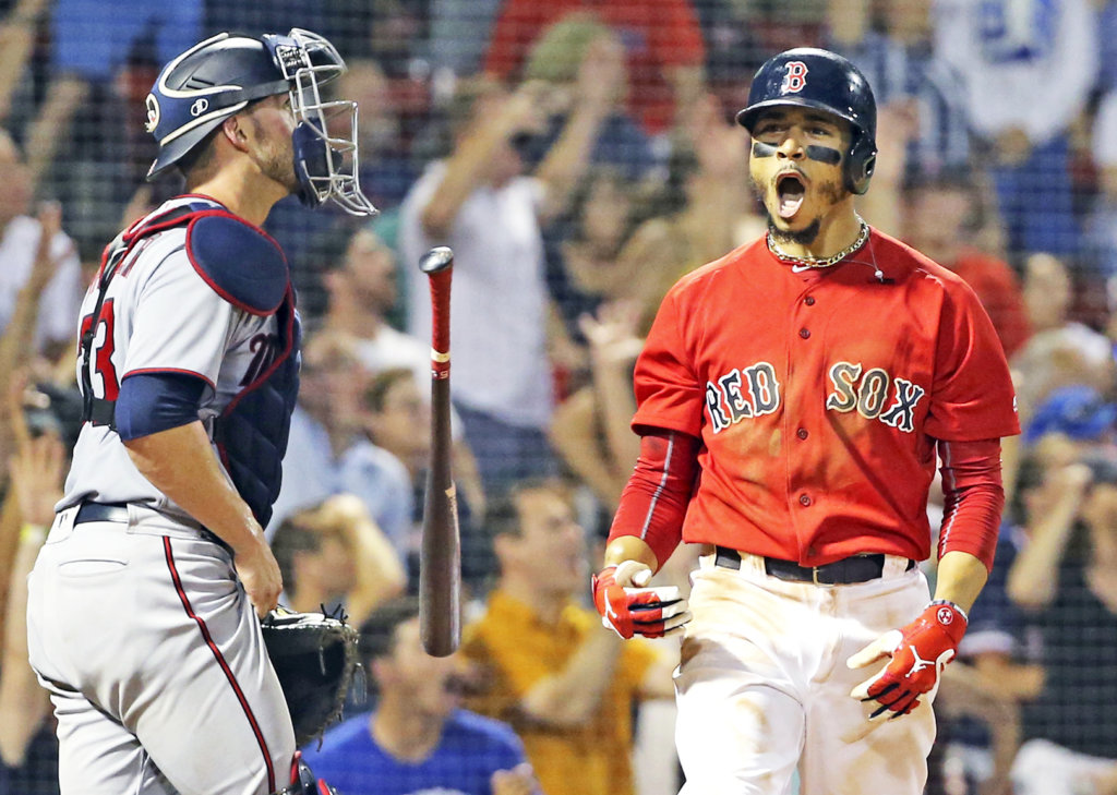 0d8f5e04130 Boston Red Sox s Mookie Betts celebrates his walk-off solo home run in  front of Minnesota Twins catcher Mitch Garver in the 10th inning at Fenway  Park on ...