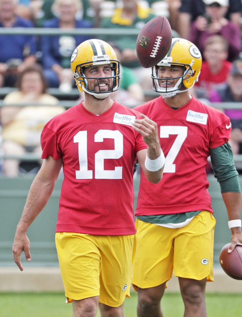 ... Bay Packers  Aaron Rodgers smiles during NFL football training camp 9075d2032