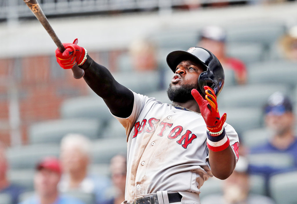f67d92805e4 Boston Red Sox infielder Brandon Phillips follows through on a game-winning  two-run home run in the ninth inning against the Atlanta Braves on  Wednesday