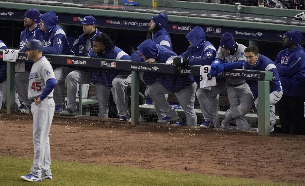 9422367bf2f Los Angeles Dodgers players watch from the dugout during the ninth inning  in Game 2 of the World Series against the Boston Red Sox on Wednesday