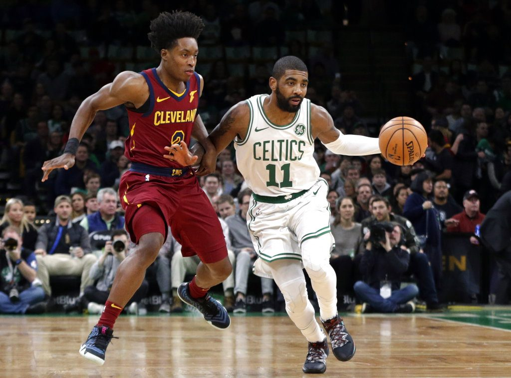 d0c636a48e1e Boston Celtics guard Kyrie Irving (11) advances the ball downcourt against Cleveland  Cavaliers guard Collin Sexton (2) during the first half of an NBA ...