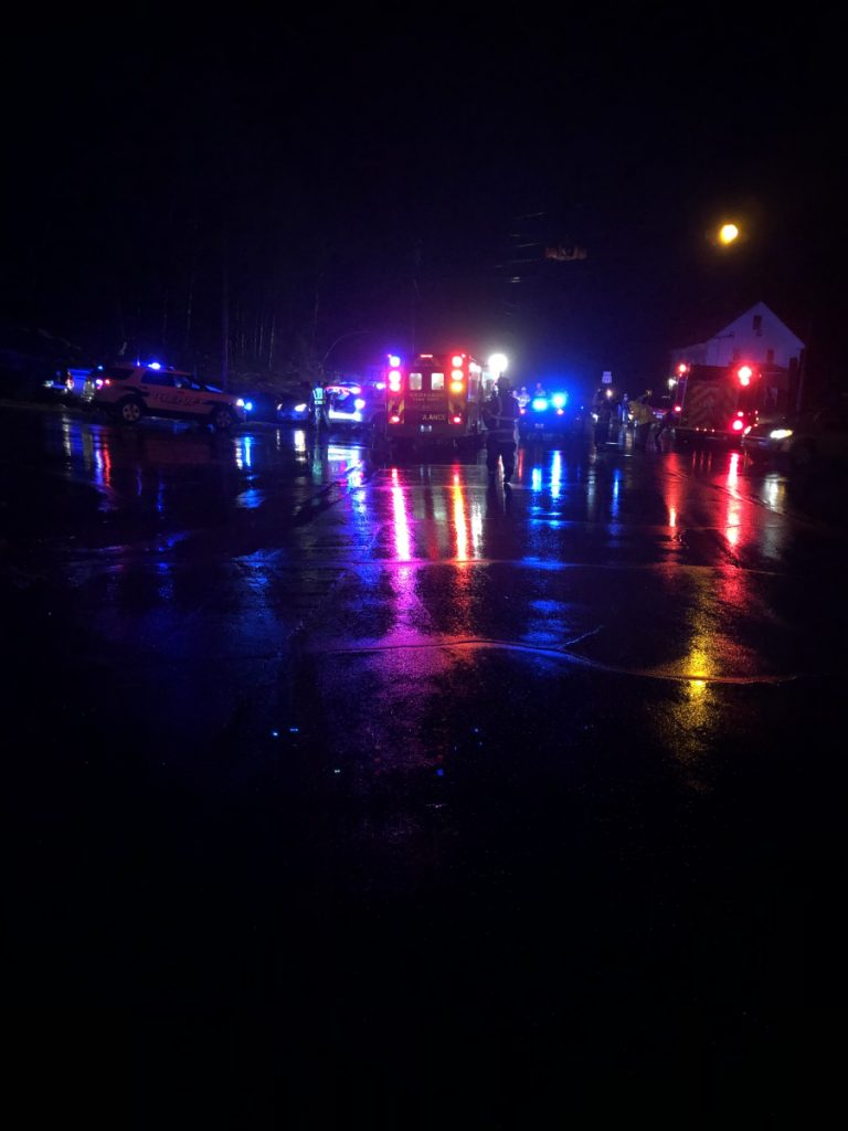 Emergency vehicles cluster Friday evening at the intersection of U.S. Route 201 and Route 197 in Richmond in response to a fatal accident that occurred there.